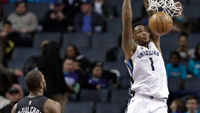 Memphis Grizzlies' Jarell Martin (1) dunks as Charlotte Hornets' Michael Kidd-Gilchrist (14) watches during the first half of an NBA basketball game in Charlotte, N.C., Thursday, March 22, 2018. (AP Photo/Chuck Burton)