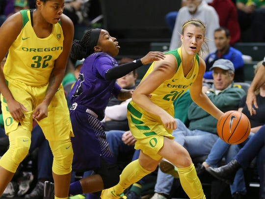 Oregon's Sabrina Ionescu drives past Weber State defender Jaiamoni Welch-Coleman during an NCAA college basketball game in Eugene, Ore., Saturday, Dec. 2, 2017.