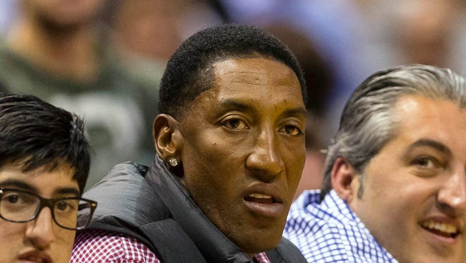 Chicago Bulls former player Scottie Pippen (center) looks on during the fourth quarter in game three of the first round of the NBA Playoffs game between the Chicago Bulls and Milwaukee Bucks at BMO Harris Bradley Center.