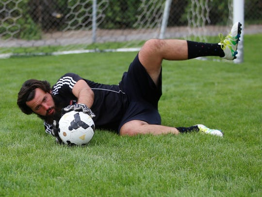 Aside from using his 6-foot-3 frame, Farmington goalkeeper