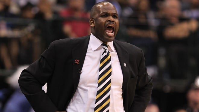 Former Portland Trail Blazers head coach Nate McMillan yells from the bench in the second half against the Dallas Mavericks in 2011.