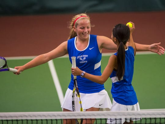 Cedar Crest Olivia Hitz (left) and Serena Cheng celebrate their No. 1 doubles win as Cedar Crest fell to New Oxford 3-2 in the first round of the District III AAA team tennis playoffs on Thursday.