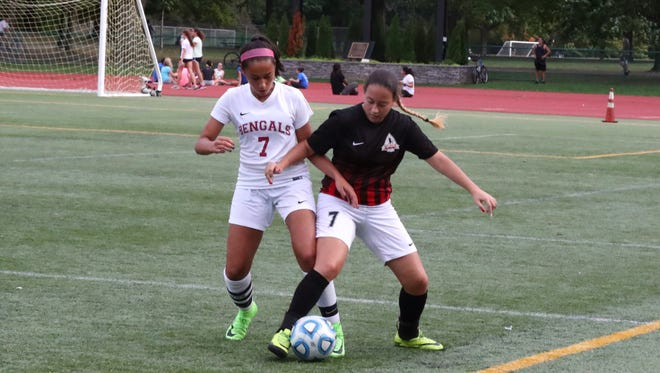Mia Nalic (left) had four assists for Bloomfield against Newark East Side.