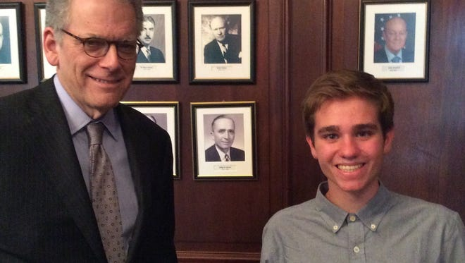 Valley student Philip Glascock and Ambassador Jeffrey DeLaurentis stand next to a photo of Glascock's relative Philip Bonsal (bottom row), a previous U.S. ambassador to Cuba.