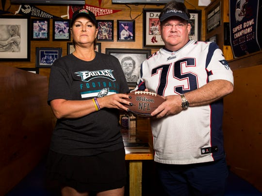 Diana Pleeter, left, owner of South Street Oven and Grill, hosted a viewing party for Eagles fans and Thom Popoli Jr., right, owner of Foxboro Sports Tavern, hosted one for Patriots fans on Sunday, Feb. 4, 2018.