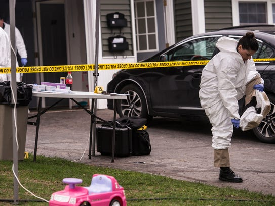 Vermont State Police investigators work at 10/12 Southview