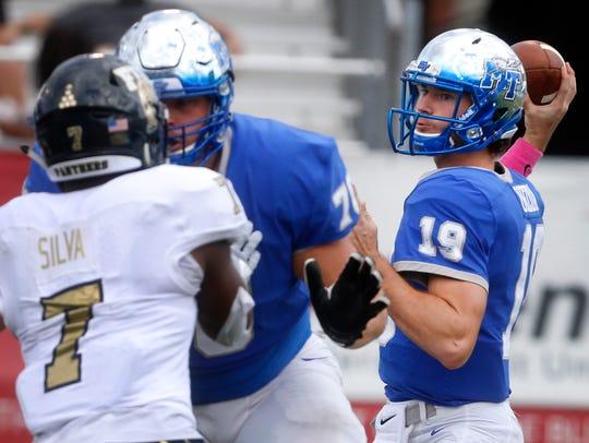 MTSU's quarterback John Urzua (19) passes the ball