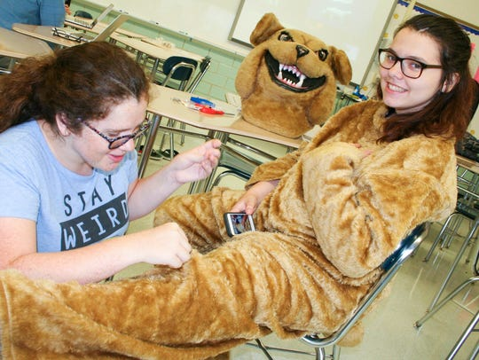 Del Val senior Shelby Padover sutures a hole in Tuffy's