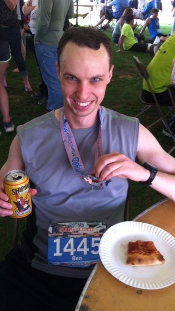 Enjoying free pizza and beer after the race.