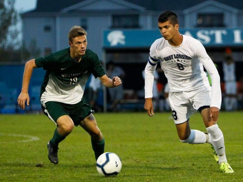 East Lansing's Quinton Hay beats Williamston's Caleb Schuiteman to the ball October 8, 2015, at the East Lansing Soccer Complex.