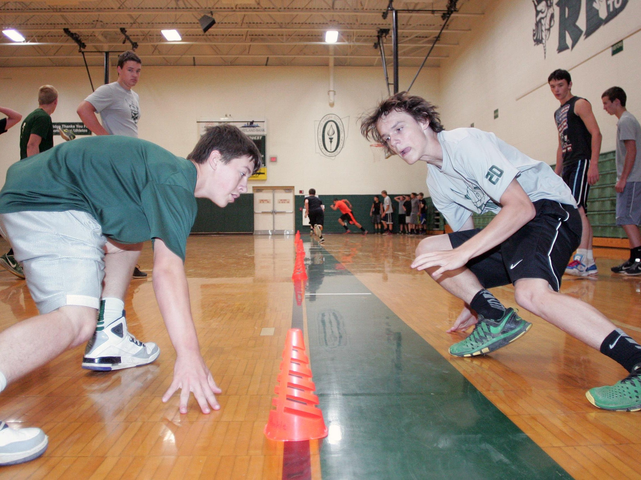 Northridge football players Nick Hatten, left, and Christopher Absten participate in summer conditioning under new coach Shawn Hinkle.