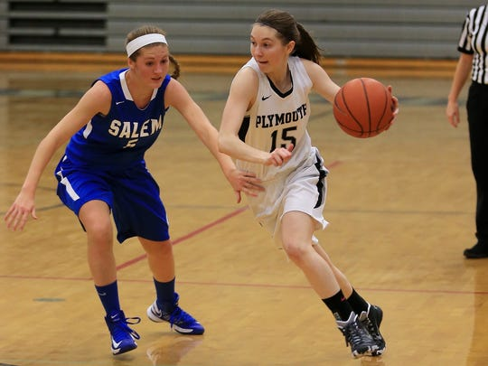Plymouth's Courtney LaVallee (right) looks to dribble around Salem defender Leah Moss during Monday night's season opener.