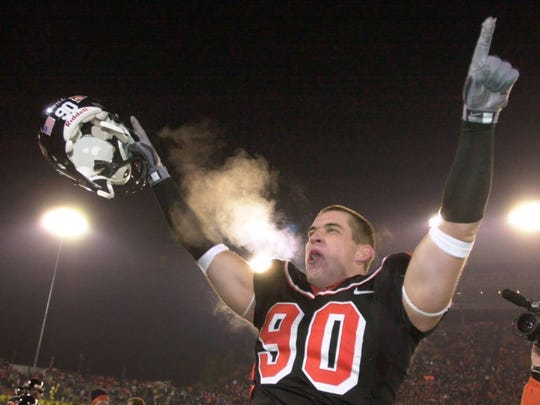 Oregon State defender Bill Swancutt celebrates their 50-21 win over Oregon during the Civil War game in Corvallis on Nov. 20, 2004.