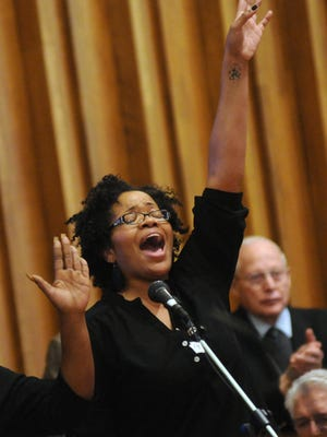 Stephanie Brabson, of Port Huron, sings along with her group during the Martin Luther King Jr. service at First Congregational Church.