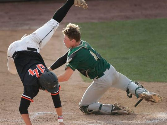 Iola-Scandinavia High School's Jayden Sivertson (34) tries to score a run against Laconia High School's catcher Seth Gosse (8) but is tagged out on the play during their WIAA Division 3 Spring Baseball Tournament semifinal game Wednesday, June 14, 2017, at Neuroscience Group Field at Fox Cities Stadium in Grand Chute, Wis. Dan Powers/USA TODAY NETWORK-Wisconsin