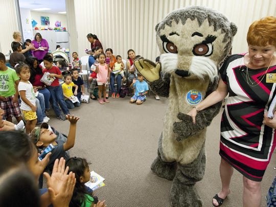 """""""Josh the Otter"""" interacts with children to promote water safety at an event presented by the Literacy Council Gulf Coast and the Rotary Club of Bonita Springs."""
