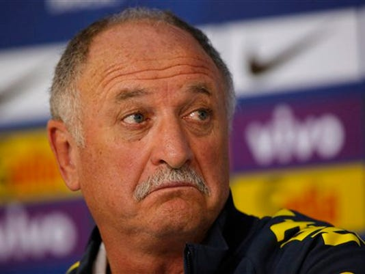 In this July 9, 2014 file photo, Brazil's coach Luiz Felipe Scolari gestures during a press conference in Teresopolis, Brazil.