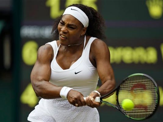 Serena Williams of the United States makes a return to Venus Williams of the United States,  during their singles match against at the All England Lawn Tennis Championships in Wimbledon, London, Monday July 6, 2015.