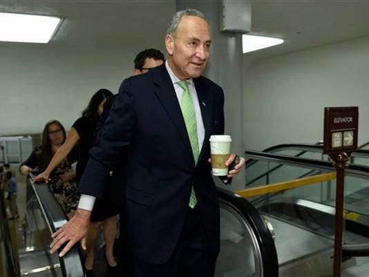 FILE -In this July 16, 2015 file photo, Sen. Charles Schumer, D-N.Y. walks on Capitol Hill in Washington. President Barack Obama suffered a temporary setback in his all-out campaign to secure Democratic support for the Iran nuclear deal as Schumer announced his opposition to the international accord. (AP Photo/Susan Walsh, File)