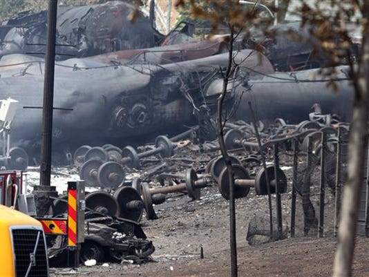This July 8, 2013 file photo provided by Surete du Quebec, shows debris from a runaway train in Lac-Megantic, Quebec, Canada.