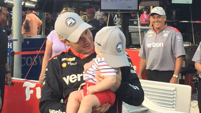 Will Power celebrates another pole with his son, Beau, Friday at Gateway Motorsports Park.