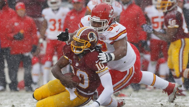 Washington Redskins quarterback Robert Griffin III (10) is sacked by Kansas City Chiefs nose tackle Dontari Poe (92) in the first quarter at FedEx Field.
