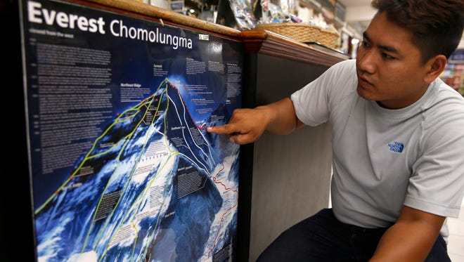 Nepalese Pemba Sherpa shows the spot on a map where a Dutch man and an Australian woman reportedly died at Camp 4 of Mount Everest, Nepal, on May 22, 2016. The two climbers died after summiting Mount Everest due to apparent altitude sickness on descent.  EPA/NARENDRA SHRESTHA