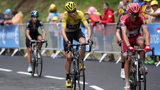 Christopher Froome rides after crashing during Stage 19 of the 2016 Tour de France  between Albertville and Saint-Gervais Mont Blanc, France.
