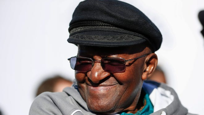 Nobel Peace Laureate Archbishop Emeritus Desmond Tutu, shown in a file photo attending  a Mandela Day event on July 18, 2016, in Cape Town, was readmitted to a hospital Sept. 18, 2016, with a infection  following recent surgery. l