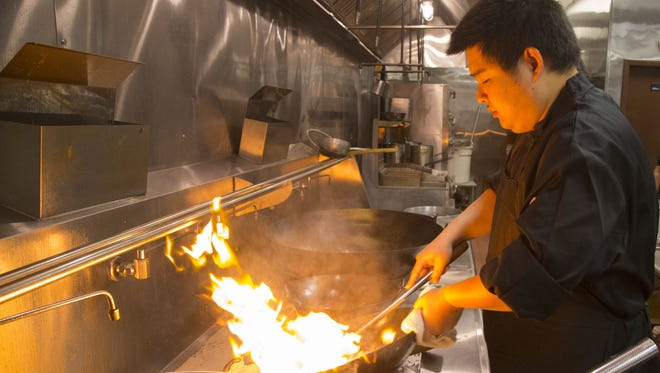 Jiang Niu prepares food at Shaanxi Chinese Restaurant on Nov. 30, 2017 in Mesa, Ariz.