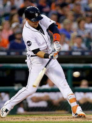 Shortstop Jose Iglesias singles to drive in James McCann during the fifth inning of the Tigers' 13-4 win over the Rays at Comerica Park.