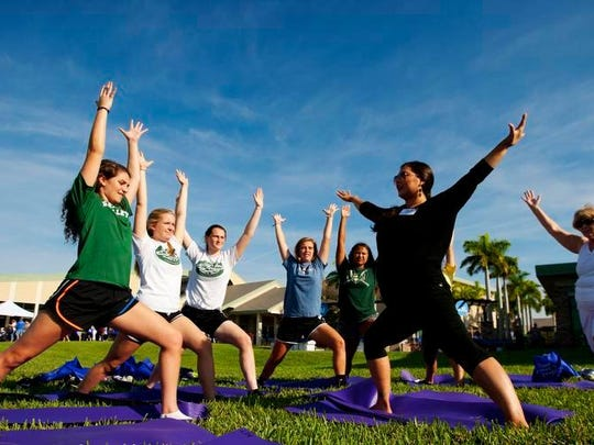 Salima Silverman teaches yoga to St. John Neumann High School students recently at the Blue Zone Project-Southwest Florida event at North Collier Regional Park in Naples. Naples wants to be a Blue Zone along with Bonita Springs, Estero, Immokalee, East Naples, Golden Gate and Marco Island. This is an 8-10 year project. Traits of people in Blue Zones are movement, eating more fruits and vegetables, a sense of purpose, strong faith, close bonds with friends and family.