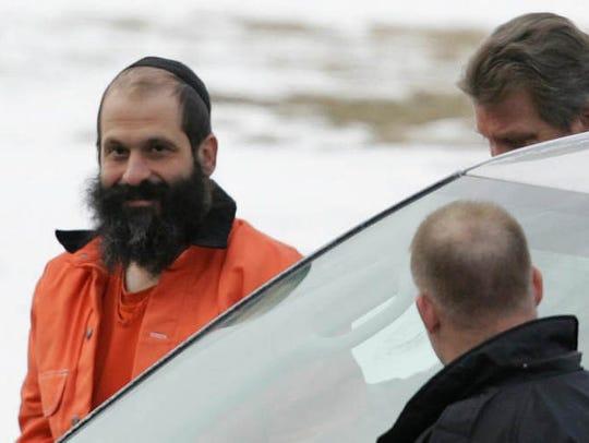 Federal agents escort Sholom Rubashkin, former head