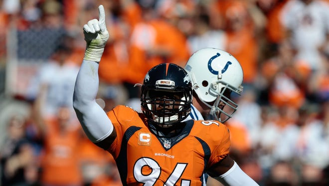 Denver Broncos outside linebacker DeMarcus Ware (94) celebrates after a play in the second quarter against the Indianapolis Colts at Sports Authority Field at Mile High.
