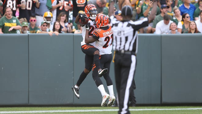 Cincinnati Bengals cornerback William Jackson (22) celebrates an interception return for a touchdown with Cincinnati Bengals cornerback Darqueze Dennard (21) in the second quarter during the Week 3 NFL football game between the Cincinnati Bengals and the Green Bay Packers, Sunday, Sept. 24, 2017, at Lambeau Field in Green Bay, Wisconsin.