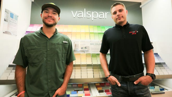 Big Star Ace Hardware owner Brennen Jeffers, right, and business partner and brother Brycen Salopek pose for a photo, Aug. 22, 2016, in front of their new paint line, Valspar.