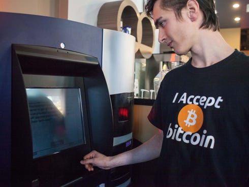 Gabriel Scheare uses the world's first bitcoin ATM on Oct. 29 Waves Coffee House in Vancouver, British Columbia.