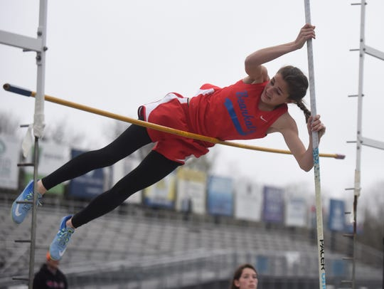 Melbourne's Kenley McCarn competes in the pole vault.