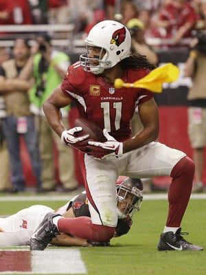 Arizona Cardinals Larry Fitzgerald catches a 4-yard touchdown pass from Carson Palmer against the Tampa Bay Buccaneers in the first half on Sept. 18, 2016, in Glendale.
