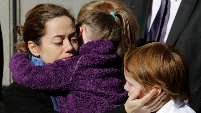 Mimi O'Donnell, estranged partner of actor Philip Seymour Hoffman, comforts two of their three children, 5-year-old daughter Willa and 10-year-old son Cooper, as his casket arrives at the Church of St. Ignatius Loyola on Feb. 7, 2014, in New York.