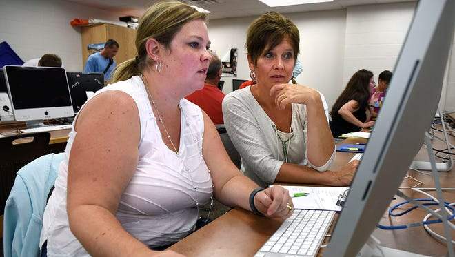 Belinda Walsh and Mona Torborg, both teachers at Cold Spring Elementary School, learn about a computer program called Kid Blog to use in their classrooms in August 2015 at Rocori High School in Cold Spring. The Central Minnesota Learning Partnership has organized a second technology summit for this August.