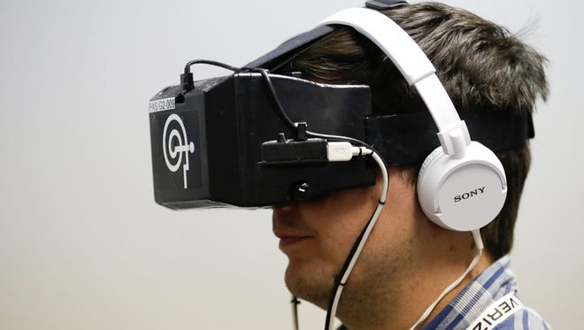 IndyStar reporter Jim Ayello under goes the I-Portal Portable Assessment System, used as part of IndyCar's concussion evaluation protocol during a demonstration at Indianapolis Motor Speedway medical center, in Indianapolis Tuesday, May 15, 2018. (AP Photo/Michael Conroy)