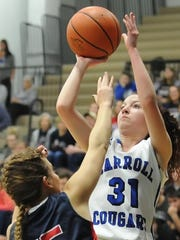 Carroll senior Macy Willoughby gets a baseline jumper off over Seeger's Britney Shipman.