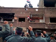 Syrian army, police celebrate recapturing all of Damascus