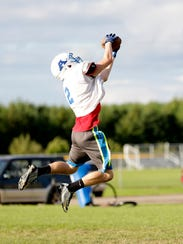 An Auburndale player catches a pass during practice