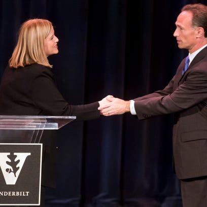 Mayoral candidates Megan Barry and David Fox shake