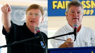 Republican Lt. Gov. Tate Reeves (left) and Democratic Attorney General Jim Hood are eyeing the open seat Gov. Phil Bryant will leave. Both are seen during the 2016 Neshoba County Fair.