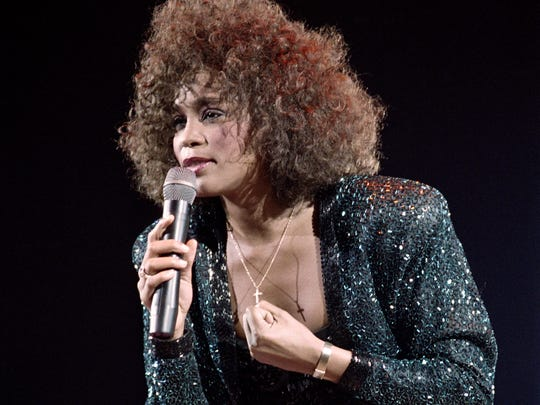 A file picture taken on May 18, 1988 in Paris shows US singer Whitney Houston performing at the POPB.