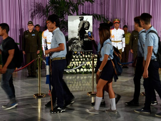 People stand in line to pay tribute to Cuba's late