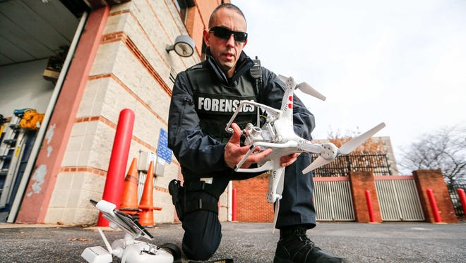 Wilmington police Master Sgt. Adam Ringle demonstrates a department drone in December. The New Castle County Council is considering spending $52,000 for a drone.